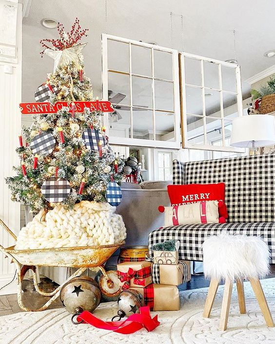 a buffalo check loveseat, a Christmas tree with buffalo check ornaments and plaid and buffalo check ribbons