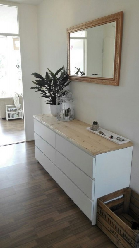 an IKEA Malm dresser hack with a wooden countertop is nice for an entryway with a minimalist feel