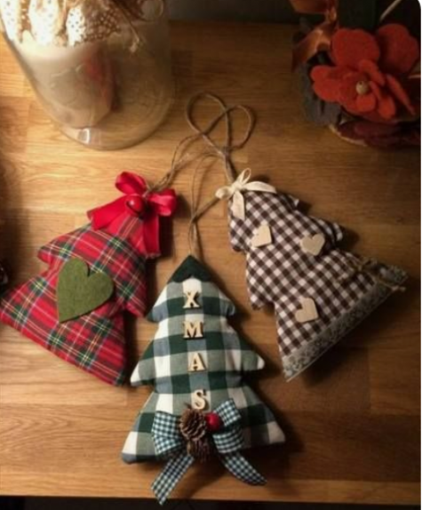 mini Christmas tree ornaments in plaid fabric, with felt hearts, berries, pinecones and twine on top