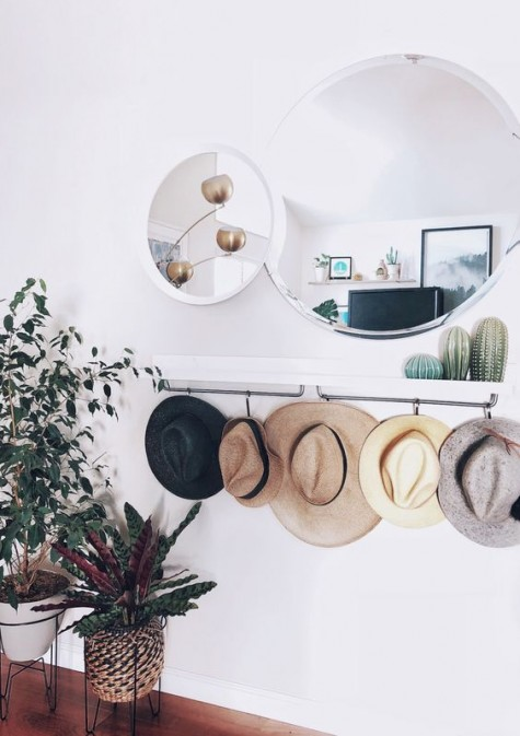 an IKEA Mosslanda shelf or sleek console with hat holders is an ultimate piece for a contemporary or boho entryway
