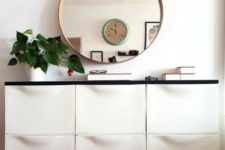 24 an IKEA Trones hack with a black countertop for a minimalist or contemporary mudroom or entryway