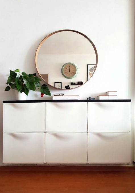 an IKEA Trones hack with a black countertop for a minimalist or contemporary mudroom or entryway