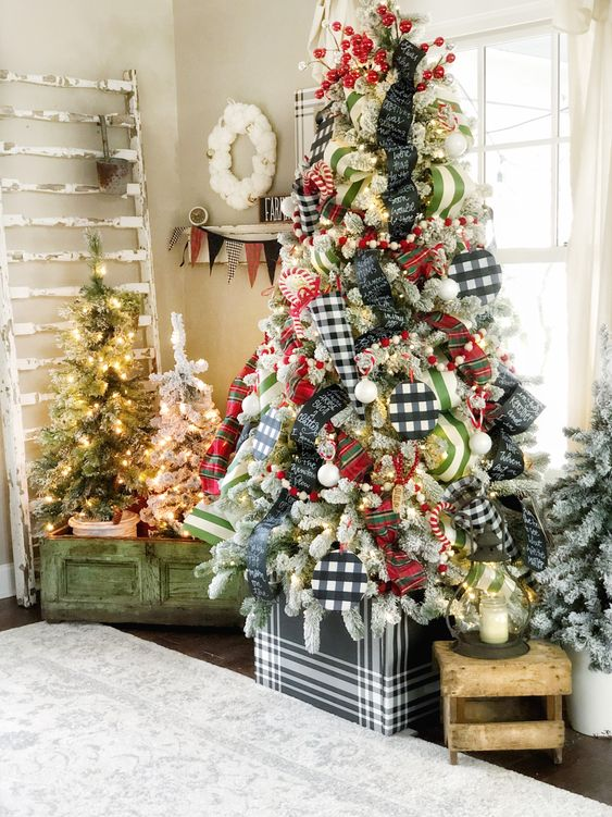 mismatching Christmas trees - all flocked but decorated with different ornaments, with no ornaments and only lights