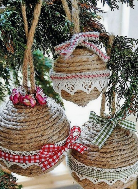 rope wrapped Christmas ball ornaments done with plaid ribbons and bows and crochet lace is a pretty vintage and rustic idea