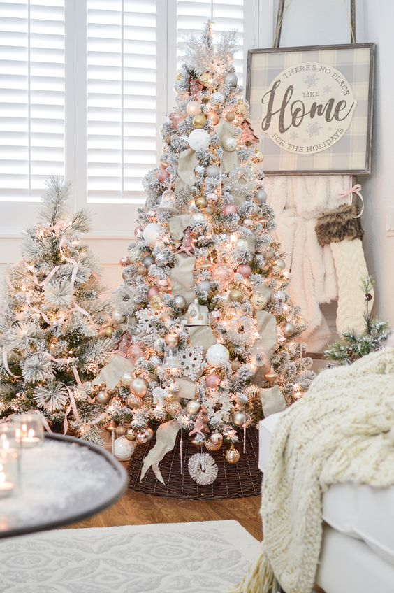two cute snowy Christmas trees with lights, pastel and metallic ornaments and some stripes for a glam touch