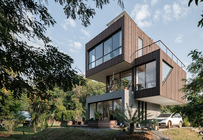 This contemporary home in rural Thailand is composed of three sculptural volumes that are stacked on each other