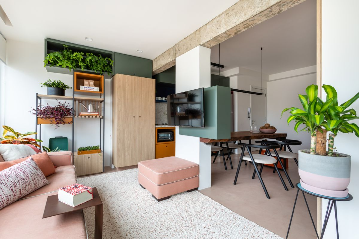 This small apartment features no inner walls but every zone is separated from the others with some smart solutions