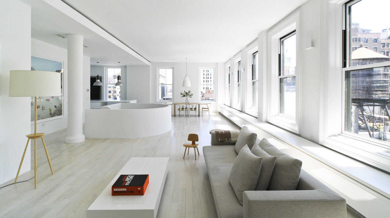 This spacious light filled loft was designed with the help of the owner who even created some furniture and artworks