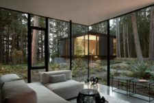 02 Glazed walls connect the spaces to outdoors and open them up, a neutral color palette doesn't distract from the views
