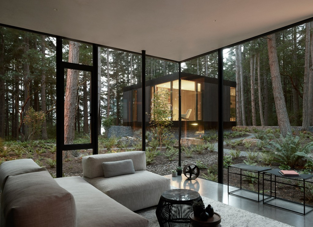 Glazed walls connect the spaces to outdoors and open them up, a neutral color palette doesn't distract from the views