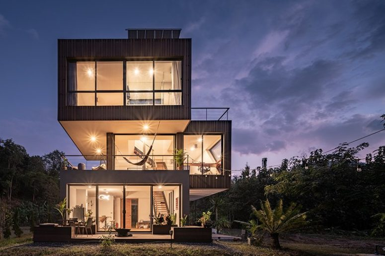 The house features glass walls and large terraces strategically placed here and there