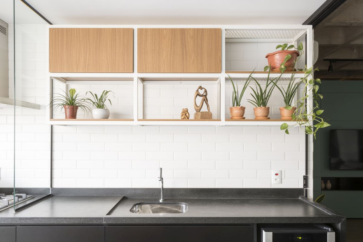 a kitchen decorated with subway tiles