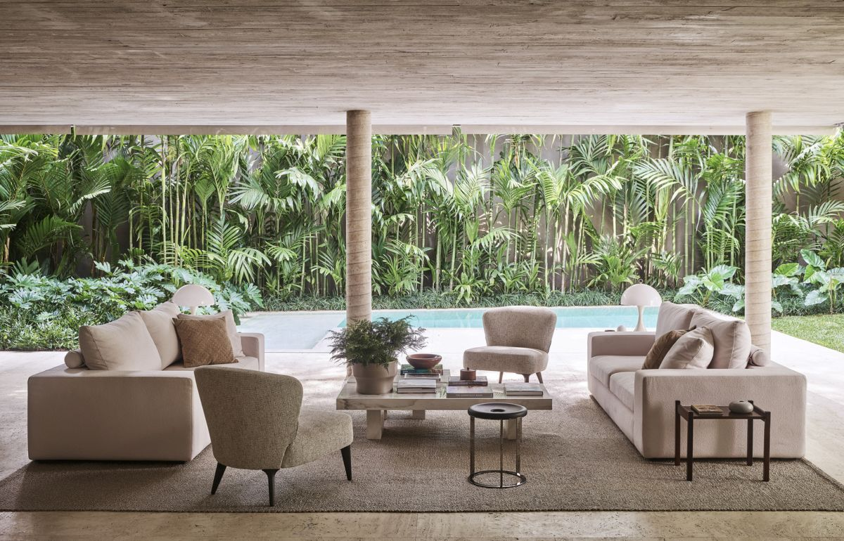 The social areas are gathered on the ground floor where they enjoy a direct connection to the pool and garden
