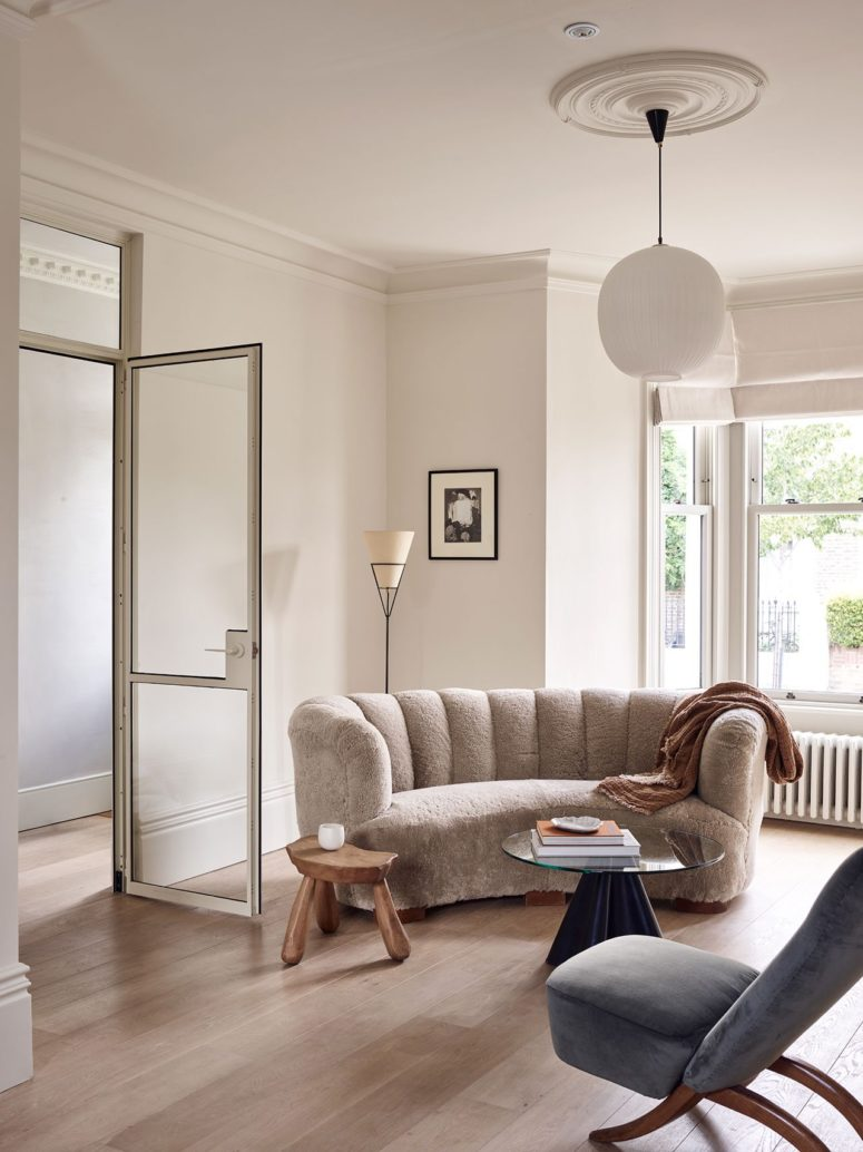 The spaces are done in chic and soothing neutrals, the existing features were left as they are