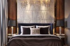 02 a luxurious bedroom with a stunning chandelier, cool lamps and gorgeous bedding plus a statement headboard