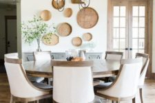 02 a vintage farmhouse dining room done in neutrals and with a large wooden round table