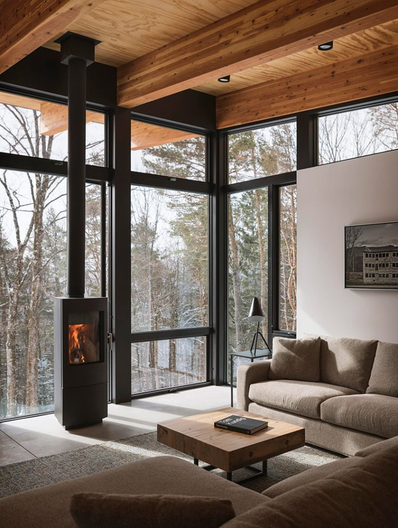 A minimalist hearth adds warmth to the space making it cozy and welcoming