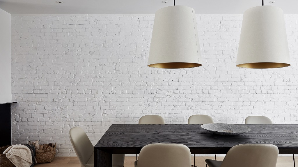 The dining space is done with a dark stained wooden table and chic leather chairs