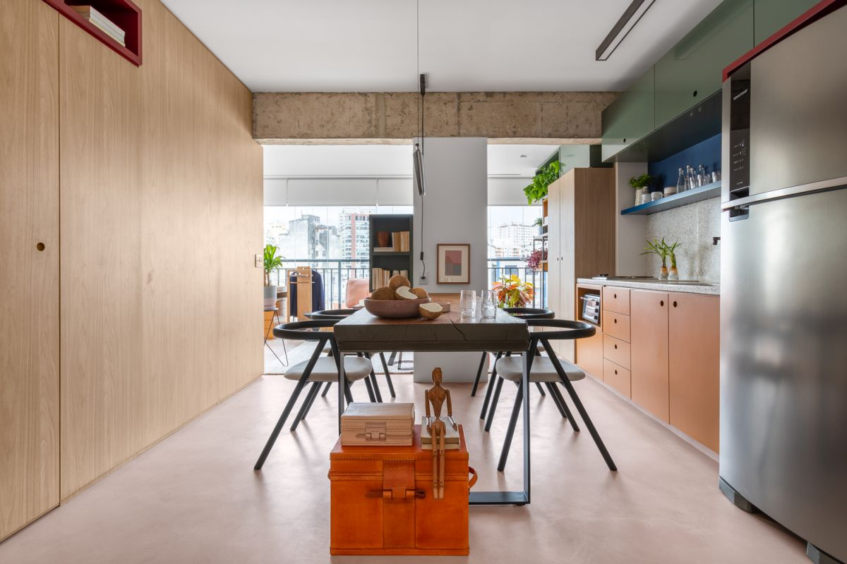 The simple materials and finishes used throughout the apartment look great in combination with all the bright colors