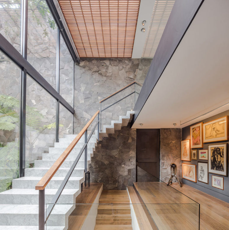 Stylish staircases connect the levels and large windows fill them with light and let enjoy the views
