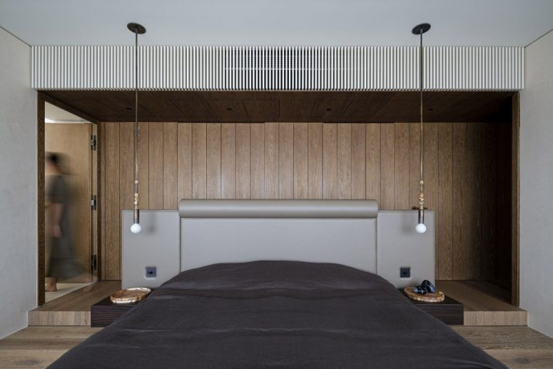 The bedroom is done with a platform bed, which is upholstered with leather