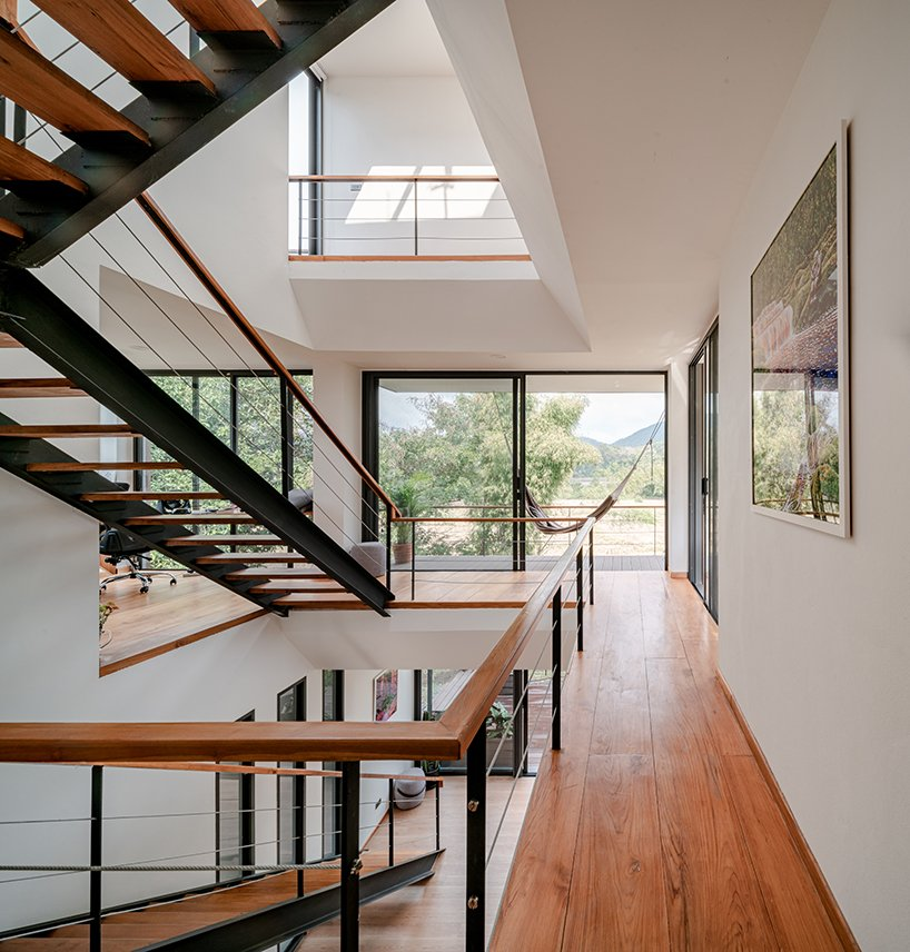 There are lots of glazed walls and large windows that allow natural light in and provide gorgeous views