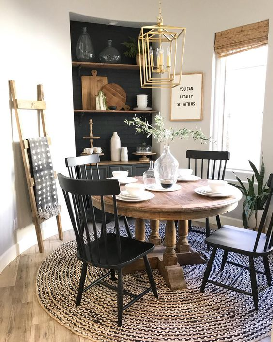 a farmhouse dining room with a vintage wooden table that sets the tone of the space and much texture