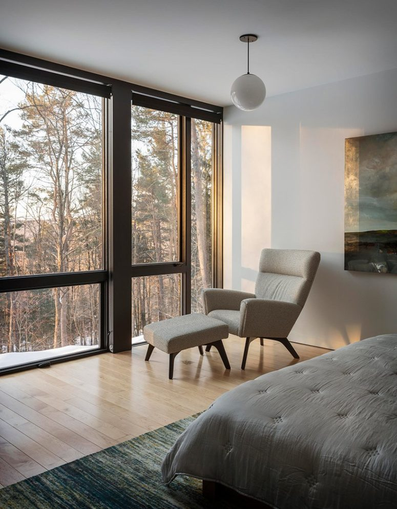 The bedroom also features amazing views through a glass wall