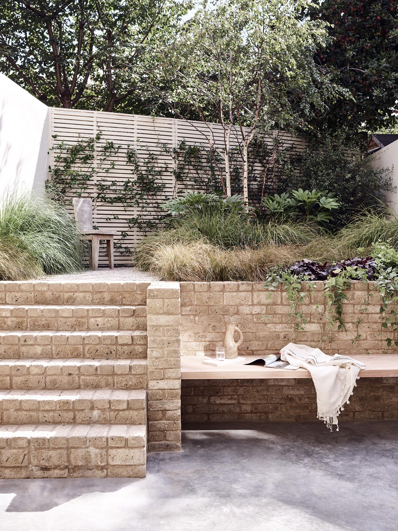The outdoor space is also manicured, its landscaping was carefully done to match