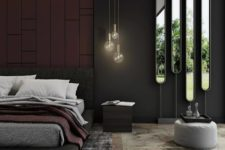 06 a gorgeous upholstered bed, an arrangement of mirrors and some bulbs for a luxurious touch