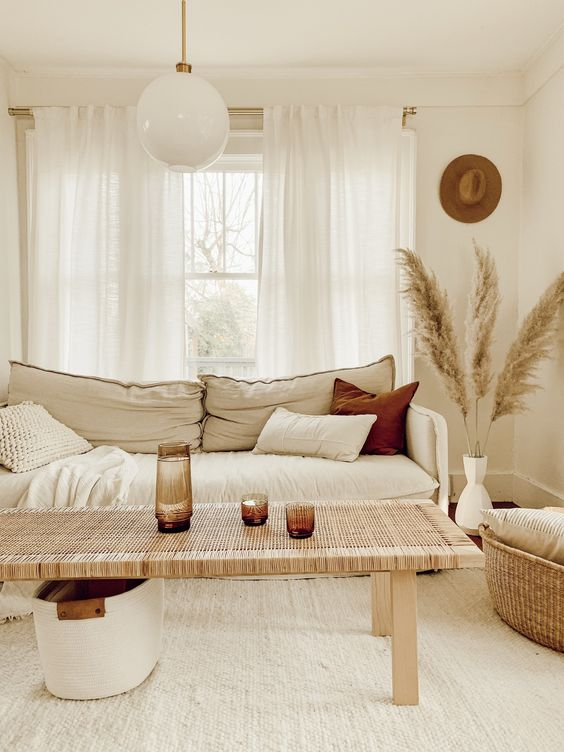 a super neutral boho space with white woven carpet flooring for a texture and to make the space bigger