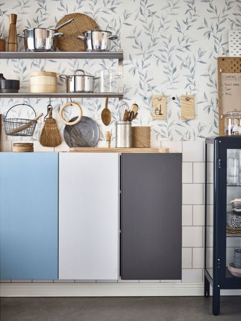 floating IKEA Ivar cabinets to comprise a kitchen, each door painted a different color