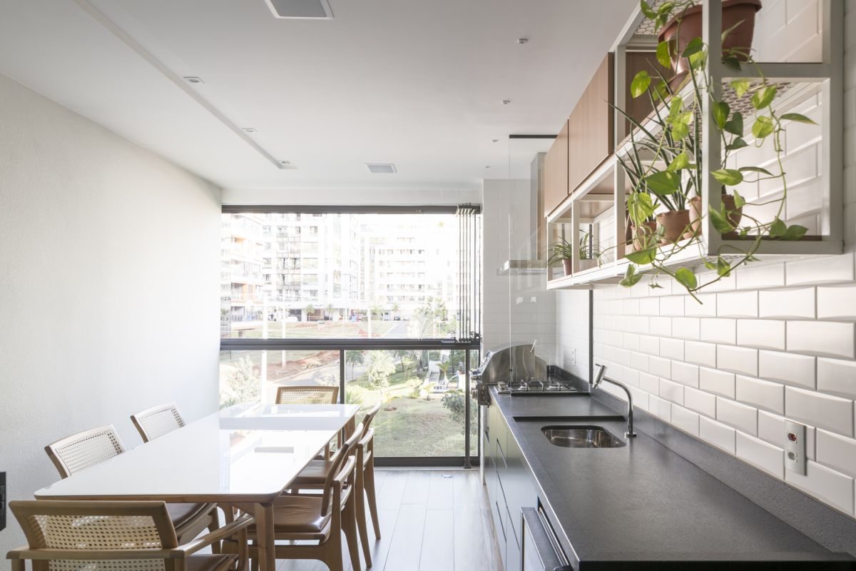 Large windows allow an abundance of natural light to enter the apartment
