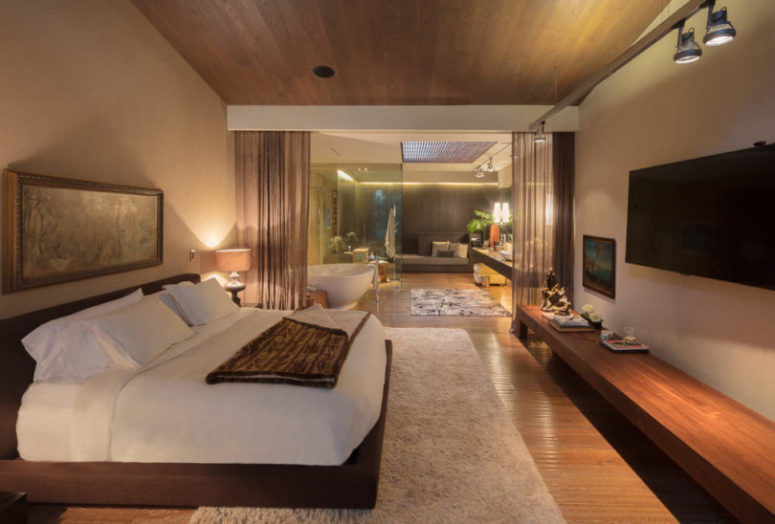 The master bedroom is done in earthy neutrals to make it warm and wlecoming, there is much upholstery and a cozy bed