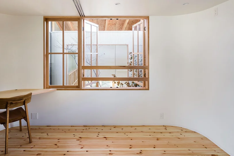 The second floor features a minimalist home office and some private zones - bedrooms