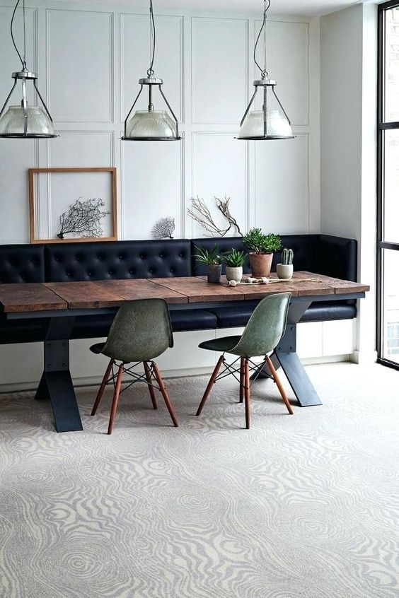 a dining space with a built in leather bench with storage, which is a gorgeous and smart solution