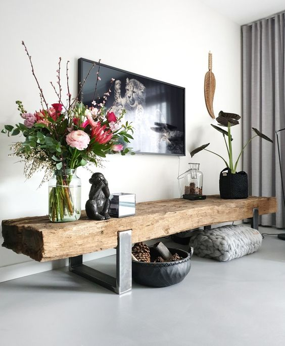 a light grey sleek floor and furniture on legs to make the space look larger and more light-filled