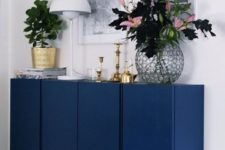 08 IKEA Ivar cabinets painted navy and with brass legs look super stylish and bold