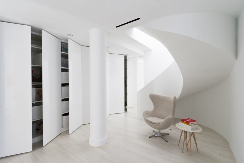 There's a sculptural staircase that leads to an open space with much hidden storage