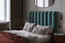 09 a voluminous and luxurious green velvet headboard makes a statement and adds color to the space