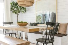 10 a cozy dining space with a table on a metal base and matching benches that repeat the table design