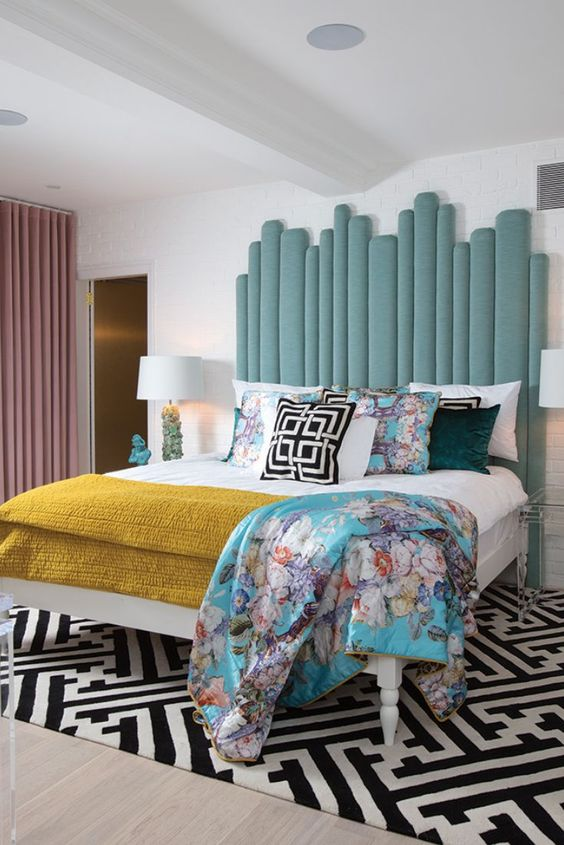 a statement light blue upholstered headboard made of planks is a stylish idea for a bright bedroom