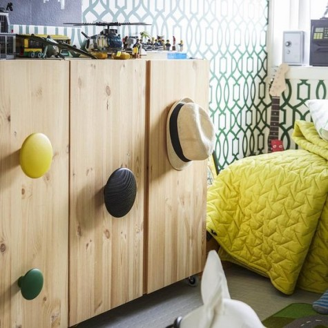 an IKEA Ivar cabinet spruced up with large round and colorful handles for a fresh modern look