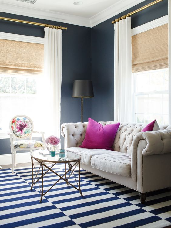 white floor-length curtains will make the space look bolder and larger, they contrast black walls