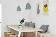 11 a chic dining space with a storage bench, a stylish wooden table and little round stools