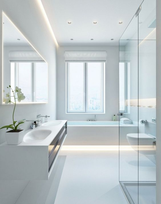 a super clean and sleek white minimalist bathroom with built-in lights, a large window and a floating vanity