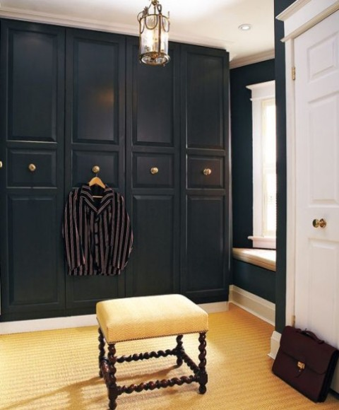 an IKEA Pax wardrobe in black with gilded knobs looks very chic and art deco