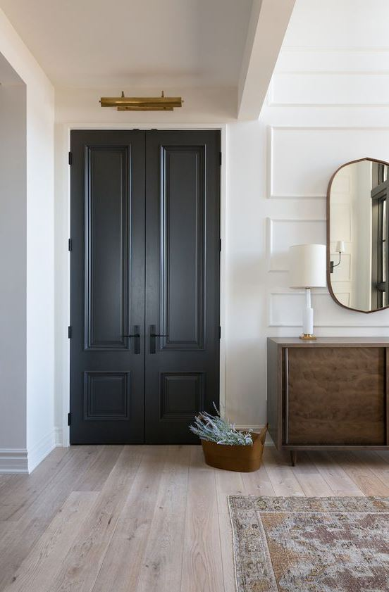 graphite grey doors look super elegant and super chic, they add interest to this neutral farmhouse space
