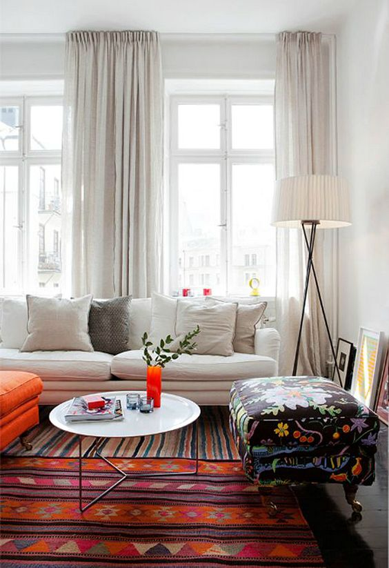 make your living room higher and large hanging such light-colored curtains up close to the ceiling