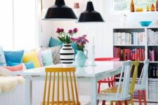 12 a neutral dining space is spruced up with colorful printed pillows and bright chairs that make a statement